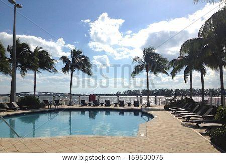 view of swimming pool palm trees and intercoastal at condominium Miami Brickell