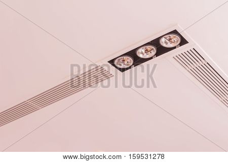 Construction details: Lighting fixtures and air grilles on plastered board ceiling