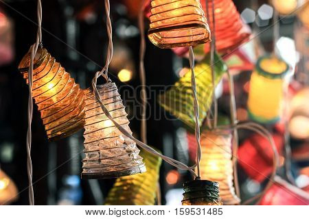 colorful paper lamp shade hanging on wire
