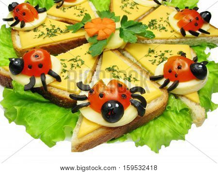creative sandwich with cheese and lady bugs made of tomato