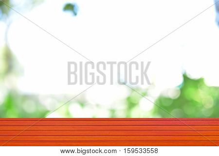Empty top wooden table orange and leaves blurred background Can use for product display.
