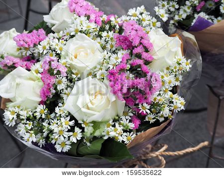 Bouquet made from white rose with complimentary flowers, Special events, Selective focus (wedding, bouquet, rose)