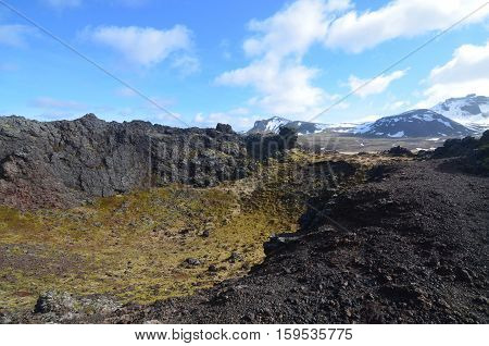 Moss covered lava rock of Eldborg Crater in Iceland.
