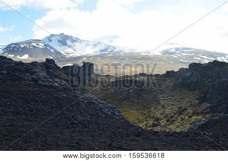 Iceland's diverse landscape with glaciers and lava rock.