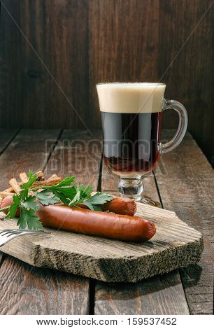 Grilled Sausages With Beer On Wood Plate