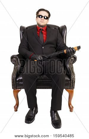 Killer sitting on chair isolated on white background.