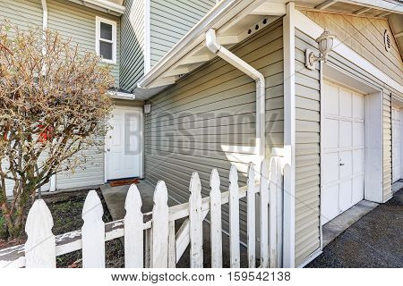 Entrance Of Duplex Home With Picket Fence