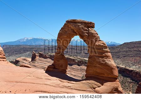 Delicate Arch a natural sandstone formation is located in Arches National Park Utah USA.