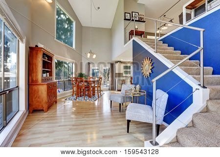 Entryway With Hardwood Floor And Staircase
