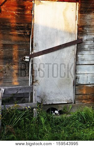 Closed Door With Old Lock On Village Farm House. Storage Building Is Closed With Lock. Closed House.
