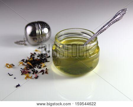 honey and flower tea with tea strainer