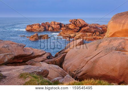 Scenic View Of Pink Granite Coast At Sunset