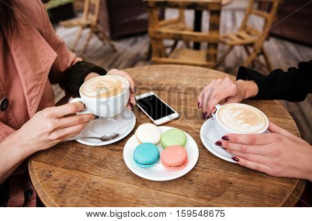 Side view of table in cafe. drinks coffee