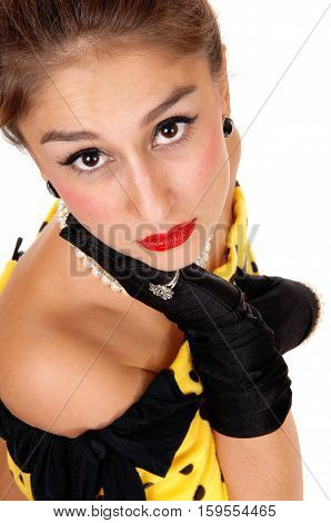 A lovely young woman in a yellow dress and black clover looking very sad into the camera isolated for white background.