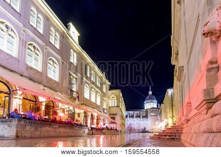 DUBROVNIK CROATIA - SEPTEMBER 22: This is one of the main streets in the center of Dubrovnik's old town with cafes and restaurants at night on September 22 2016 in Dubrovnik