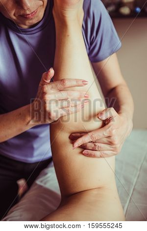 foot massage. Woman having sports foot massage. rejuvenating foot massage for athletes in Spa Salon