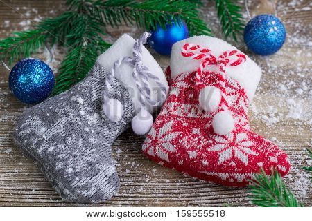 Two Christmas Stockings On Snowbound Wooden Background, Blue Balls