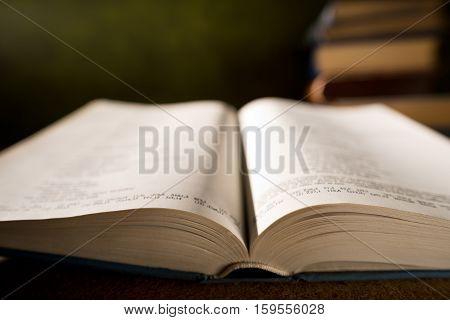 detai of open book in the bookshelf