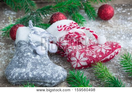 Christmas Stockings On Snowbound Wooden Background With Red Balls Ornament