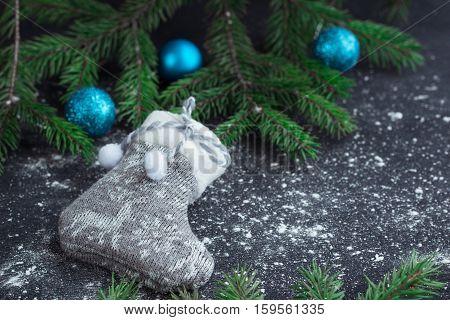 Christmas Grey Stocking On Snowbound Black Background With Blue Balls