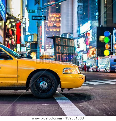 Yellow cabs in Manhattan NYC. The taxicabs of New York City at night Time Square.