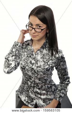 Young business woman in glasses on white background