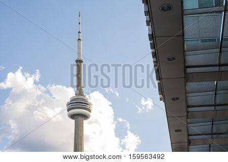 TORONTO,CANADA-AUGUST 1,2015:view of the CN towers in Toronto during a sunny day from une of the central street of the city.