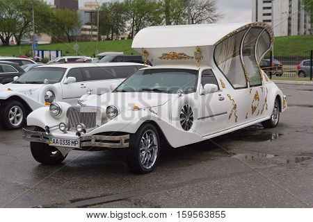 Kiev Ukraine - April 15 2016: Luxury wedding limousine in the parking lot is available for rent