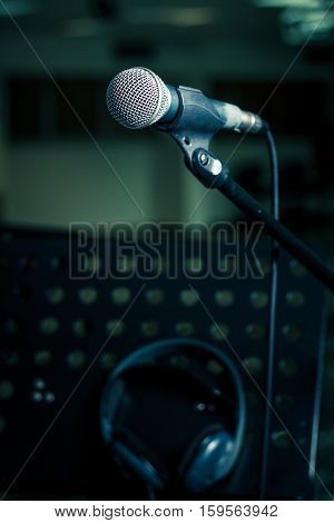 Microphone in holder on stand on blur background. Close-up selected focus