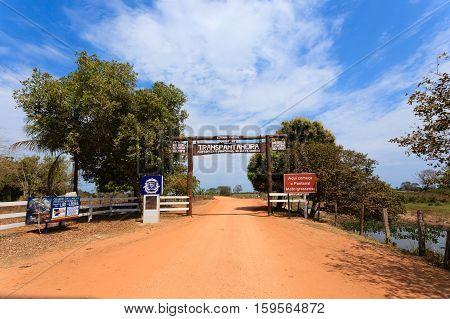 Pantanal entrance gate along Transpantaneira dirt road. Brazilian landmark. Road in perpective