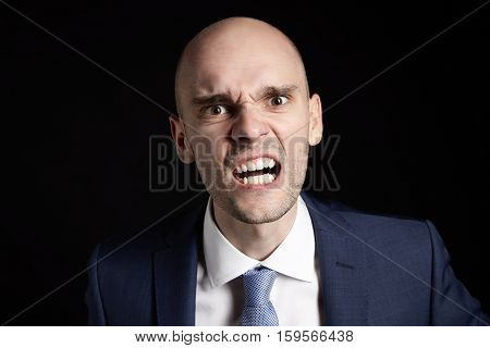 Businessman Aggressively Shows Teeth