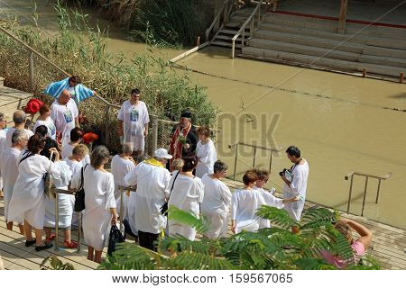 Jericho, Israel - November 1, 2016: Group of Pilgrims at the Baptism Site called Qasr el Yahud. Its located at Jordan River in the Region of the West Bank in Israel