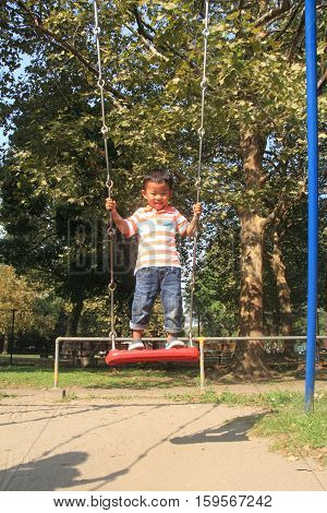 Japanese boy on the swing (4 years old)