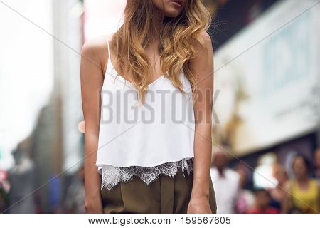 Beautiful fashion girl wearing white cotton top and gey pants outfit