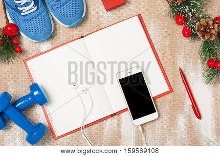 Christmas Sport Composition With  Shoes, Dumbbells, Noteboo