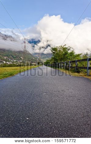 Asphalt road in the mountains of Italy soft focus