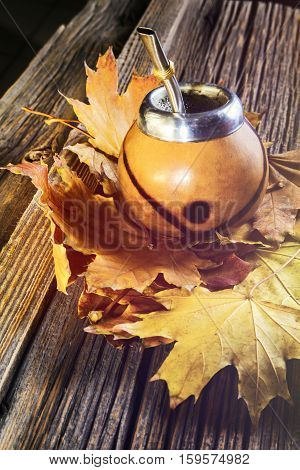Mate gourd on vintage wooden table close up