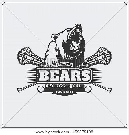 Hockey club emblem with head of bear.