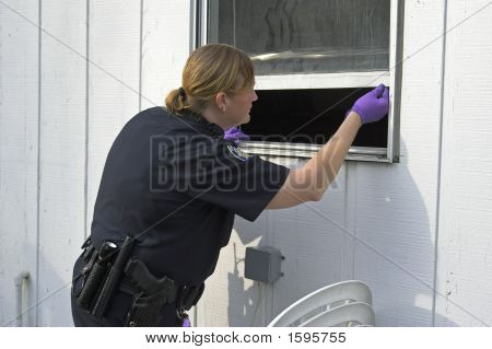 Police Officer Dusting Prints