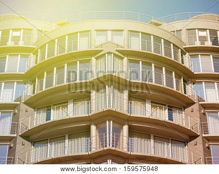 Modern large apartment building on sunny day