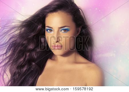 beautiful fantasy woman with tanned skin and summer makeup