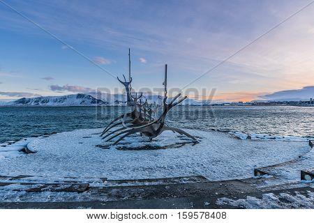 REYKJAVIK, ICELAND - 28 FEBRUARY 2016: Sun Voyager (Icelandic: Solfar), landmark sculpture on the seaside of Reykjavik by Jon Gunnar Anarson during sunrise in winter