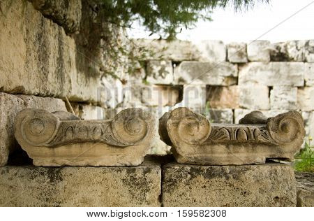 Closeup Of Old Greek Columns Capitals At The Akropolis. Athens, Greece