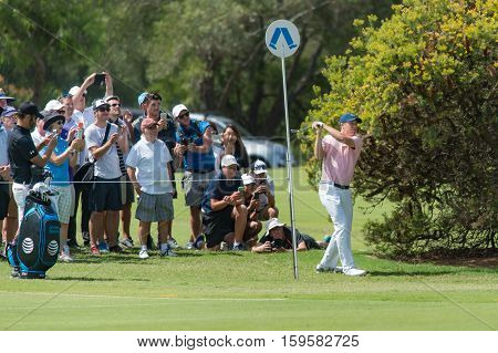 Sydney, Australia - November 16, 2016: American golf professional Jordan Speith playing a shot left-handed on the 8th hole with his caddy capturing the shot on his mobile phone during the Pro-am at the Emirates Australian open at Royal Sydney Golf Club on