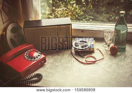 Vintage objects on windowsill. Retro home interior