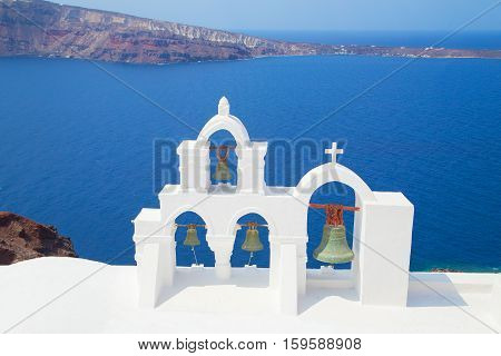 bwhite church bells, eautiful sights of Santorini island