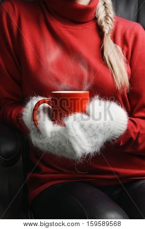 Girl In Red Sweater And White Mittens Holding Cup