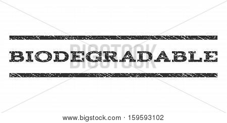 Biodegradable watermark stamp. Text caption between horizontal parallel lines with grunge design style. Rubber seal gray stamp with unclean texture. Vector ink imprint on a white background.