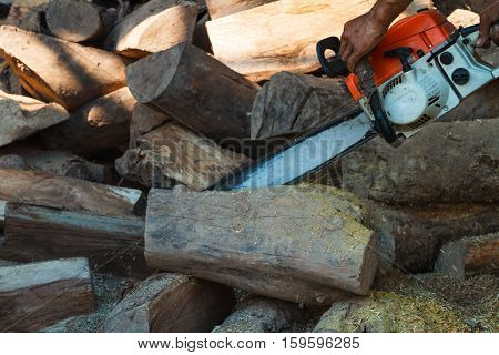 Chainsaw cut timber in wooden manufacturing industry.