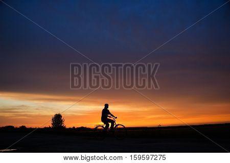 male mountain bike cyclist silhouette sunset sky
